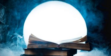 An open book of spells in full Moon. Reader imagination and writing inspiration concept with copy space