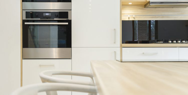 Modern kitchen with integral oven, microwave, built-in cabinets in scandinavian style