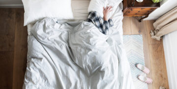 Person on bed insomnia and noise pollution concept